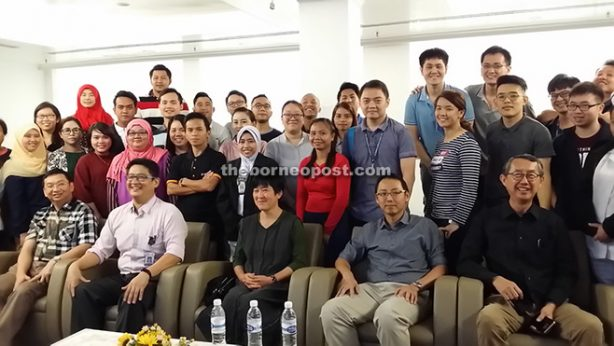 Ng (seated right) with Dr Loh (seated centre) and others pose with participants of the seminar.